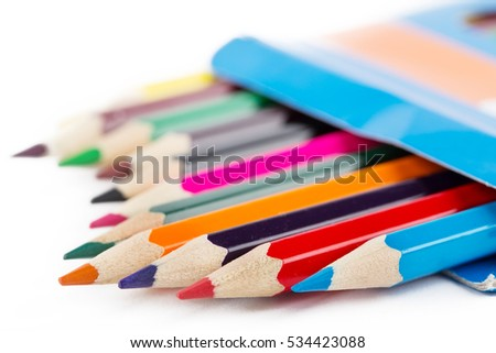 Colored pencils in box shot with selective focus isolated on white background