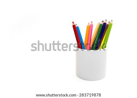 Colored pencils in mug on white background - stock photo