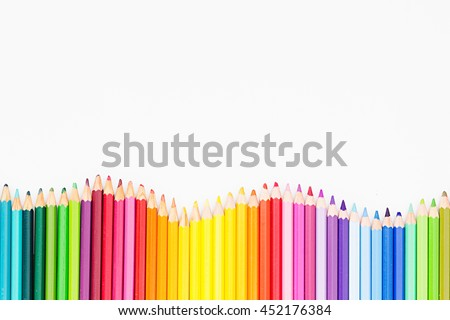 Colored pencils in rainbow order on white background. Pencils background.