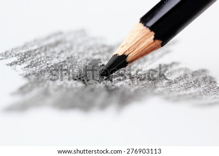 Colored pencils in the White background,black,shallow depth of field