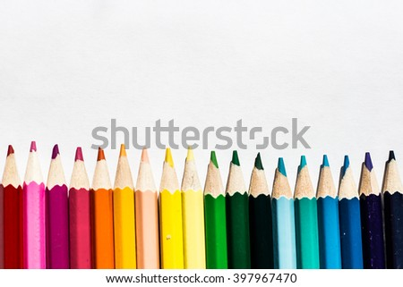 Colored pencils isolated on white background close up