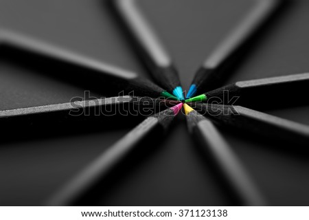 colored pencils, on black background - stock photo