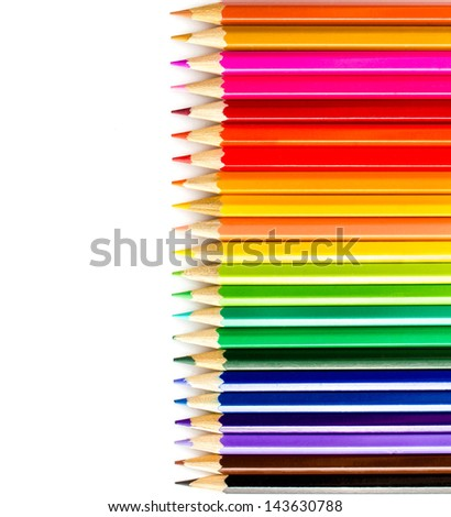 Colored pencils rainbow on white background - stock photo