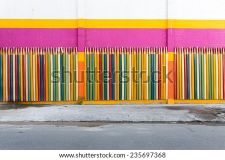 colored pencils wall background near Dam Sen park - stock photo