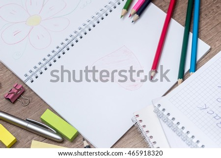 colored pencils with a notebook for training