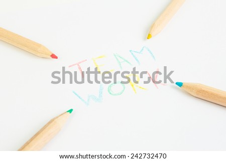 Colored pencils writing team work.