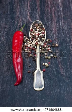 colored peppers mix, red chilly peppers  on a wooden table,  selective focus - stock photo