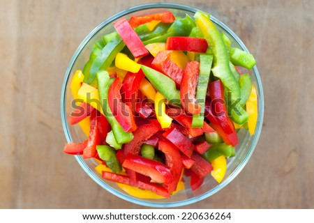 Colored peppers mixed in a glass bowl - stock photo