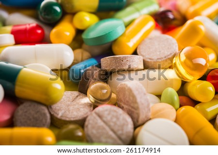 Colored pill capsule on background
