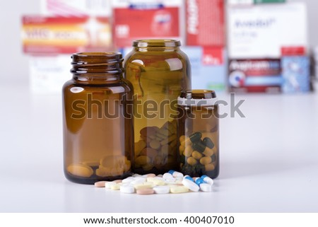 Colored pills and tablets on white background