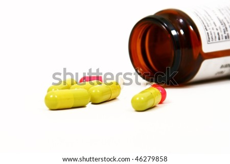 Colored pills isolated on white background - stock photo