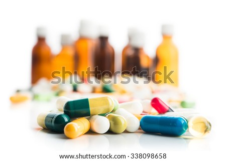 Colored pills on white background - stock photo