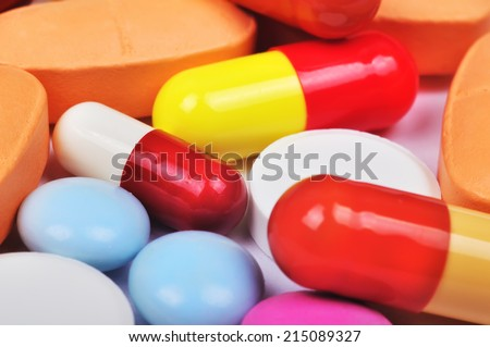 Colored pills, tablets and capsules, close up