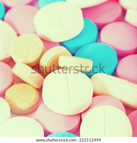 Colored pills, tablets and capsules. Vintage retro style - stock photo