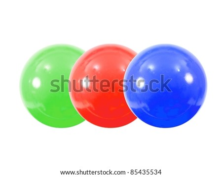 Colored pit balls isoated against a white background
