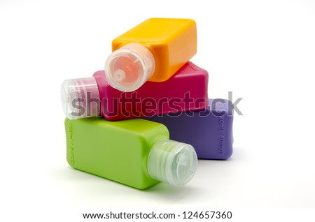 Colored plastic bottles of 100ml - stock photo