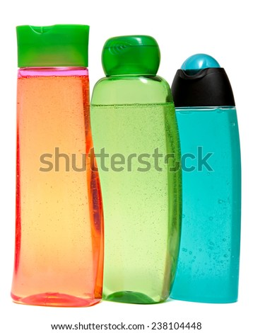 colored plastic bottles with liquid soap and shower gel isolated on white background . Studio shooting. Set. close up of beauty hygiene container on white background  - stock photo
