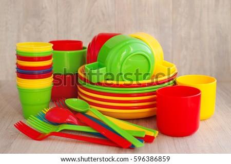 Colored plastic ware. Tableware for a picnic made of colored plastic. A stack of & Colored Plastic Ware Tableware Picnic Made Stock Photo (Royalty Free ...
