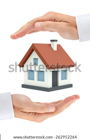 Colored private house between two businessman hands. Conceptual image - stock photo