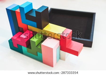 colored puzzle pieces in a black box