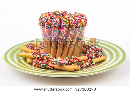 Colored rainbow (chicken legs) baked breadsticks isolated on white. With clipping path.