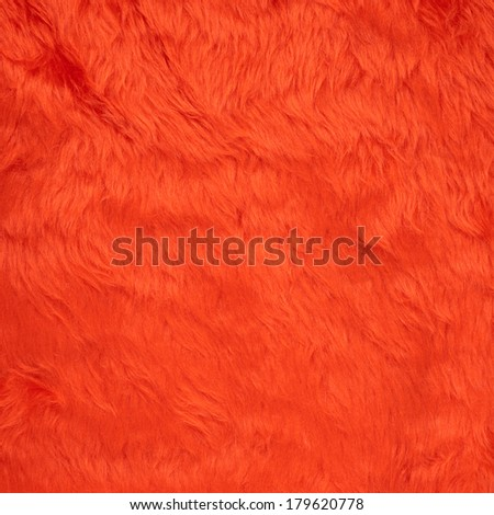 Colored red faux fur texture background fragment - stock photo