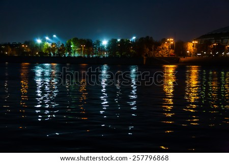 colored reflection of lamps in the night river