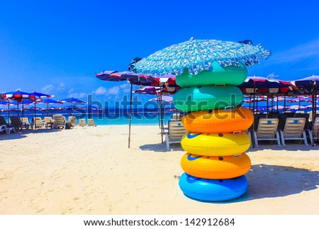 Colored ring on the beach at coral island or Koh Larn ,Pattaya T - stock photo
