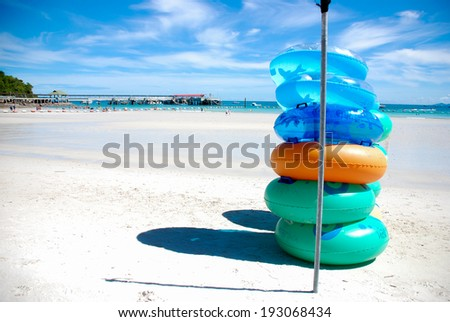 Colored ring on the beach at Koh Larn ,Pattaya, Thailand. - stock photo