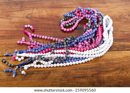 colored rosary in