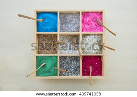 colored sand decoration in square wood box with  wooden spoon