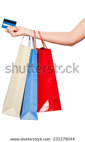 colored shopping bags holden by a woman hand with credit card, on white