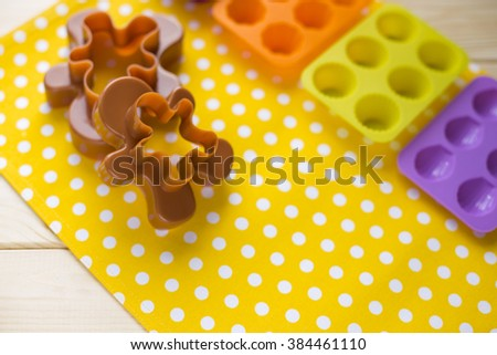 colored silicone bakeware. Forms for the cookies cut gingerbread man - stock photo