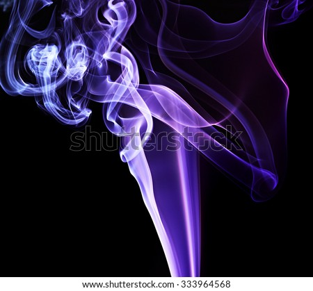 Colored smoke on black background