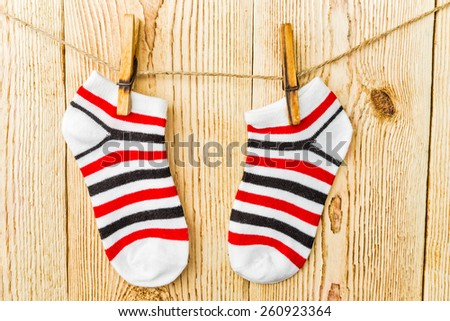 colored socks on the clothesline   - stock photo