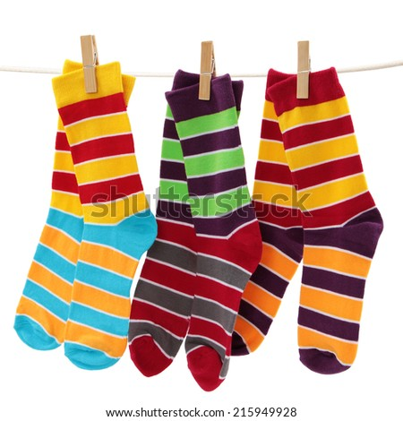 colored socks on the clothesline isolated on white background - stock photo