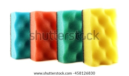 Colored sponges for cleaning and washing dishes isolated on white - stock photo
