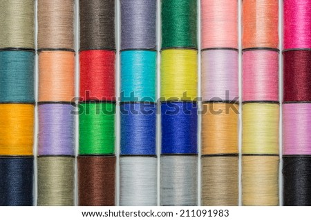 colored spools of cotton thread