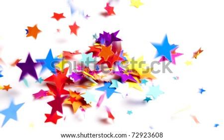 colored stars confetti falling on white - stock photo