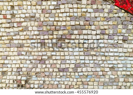 Colored stone and glass mosaic, textured wall. - stock photo
