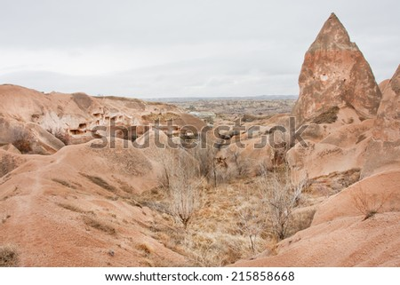 Colored stone formations yellow and red colors in valley of Cappadocia, Turkey  - stock photo