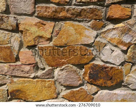 Colored stone wall. background or texture - stock photo