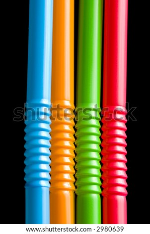 Colored straws isolated on black background