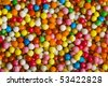 colored sweet candies spreading surface top view  background - stock photo