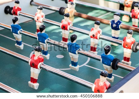colored table football game with young players.