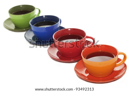 Colored tea cups lined up in diagonal order - stock photo