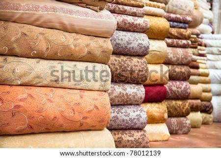 Colored textile in a traditional east bazaar, Shiraz, Iran - stock photo