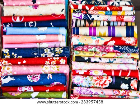Colored textile on a traditional east bazaar in Kyoto, Japan.  - stock photo