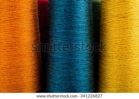 colored thread spools of thread large class, textiles, background larger image