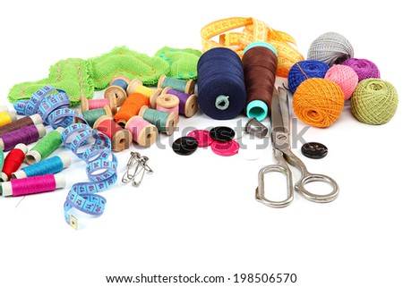 Colored threads, buttons, fabric and scissors isolated on white background.